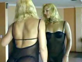 Pretty tranny in cobweb dress strips before mirror