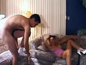 Guy and blond ts clean each others pipes on sofa