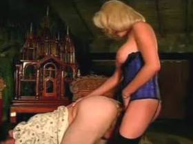 Cute blonde shemale in blue corset fucks with her lover